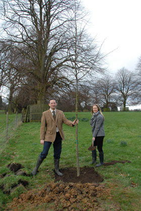 Mark and Clare Oglesby planting a tree in the Lime Tree Walk