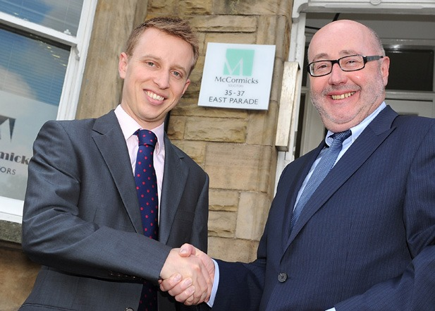 Commercial Litigation specialist Phil Edmondson is welcomed to McCormicks Solicitors by Senior Partner Peter McCormick