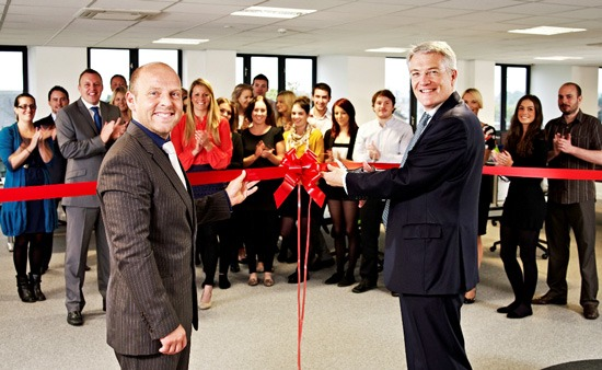 A cut above: Andrew Jones MP (right) officially opens NCI's new customer services facility under the watchful eye of NCI's Neil Richards-Smith (left) and the team.
