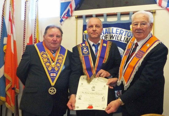 Don Middleton the dept Grand master of England (left), worshipfull grand master of the world Ronnie Bather (right) presenting Dale Dale Parkyn Worshipfull master of Harrogate 1685 (centre) presenting the warrant and lodge seal earlier this year