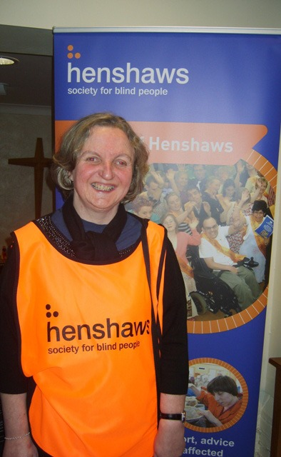 Debs, Henshaws-service-user, welcomes visitors on the door