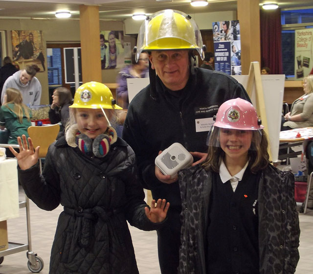 North Yorkshire Fire Service's Malcolm Dunford talks to 10-year-old Taylor Leworthy and Daniella Pilkington from Starbeck School about a career in the fire service
