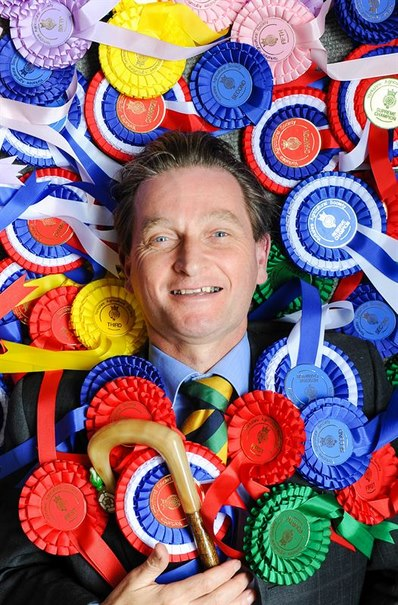 Nigel Pulling Chief Executive of the Yorkshire Agricultural Society, surrounded by rosettes in preparation for the start of this year's Great Yorkshire Show
