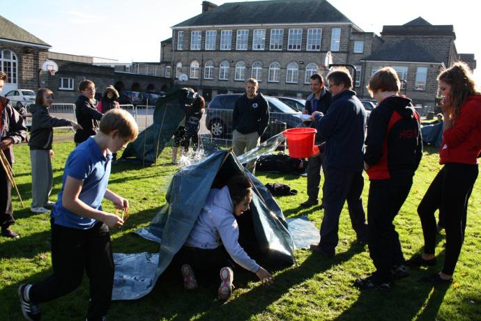 Year 9 students doing the Risky World challenge – testing their shelters are weatherproof