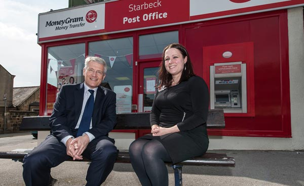 Andrew with postmistress Gemma Chowdhury outside the updated Post Office