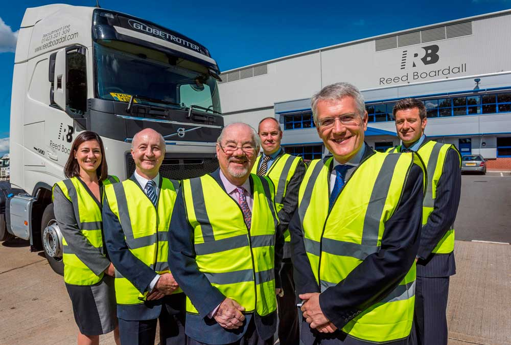 Sarah Roberts, finance director; Marcus Boardall, deputy chief executive; Keith Boardall, group chief executive; Andrew Baldwin, managing director of the cold storage division (behind); Andrew Jones MP and Howard Gill, managing director of the transport division