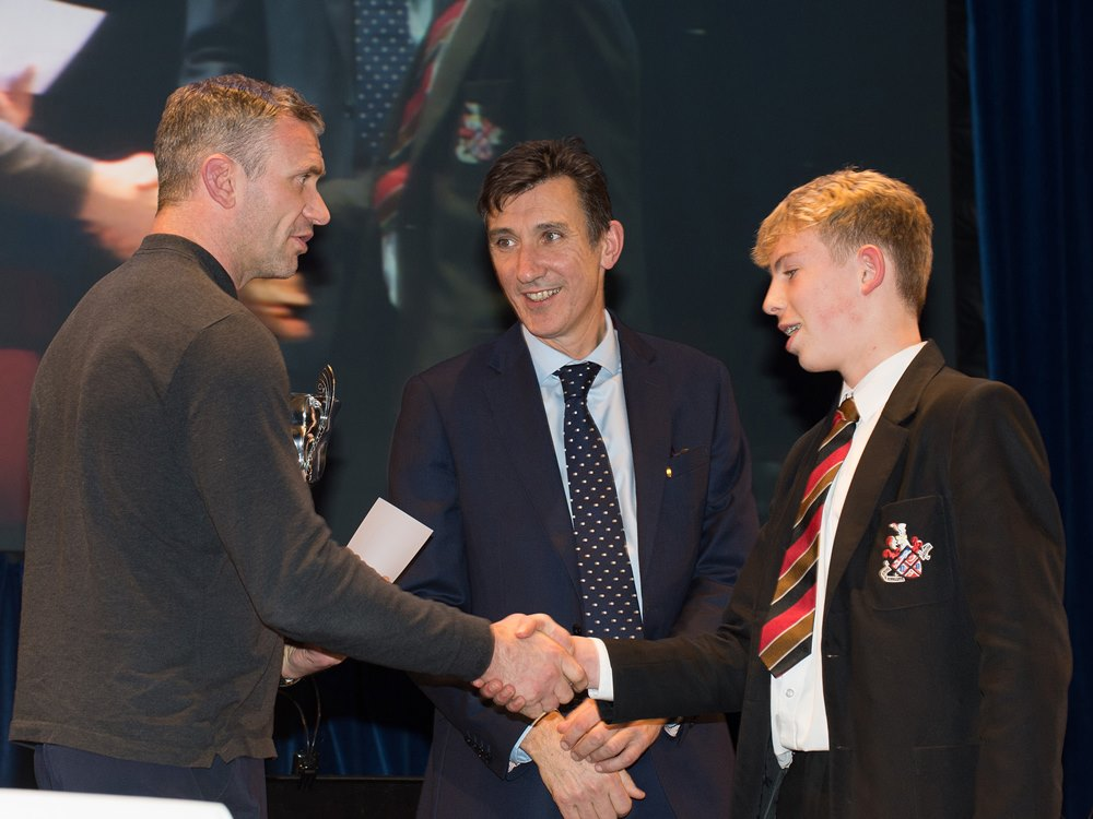 Jamie Peacock, with Headteacher Richard Sheriff presenting an award to a HGS student