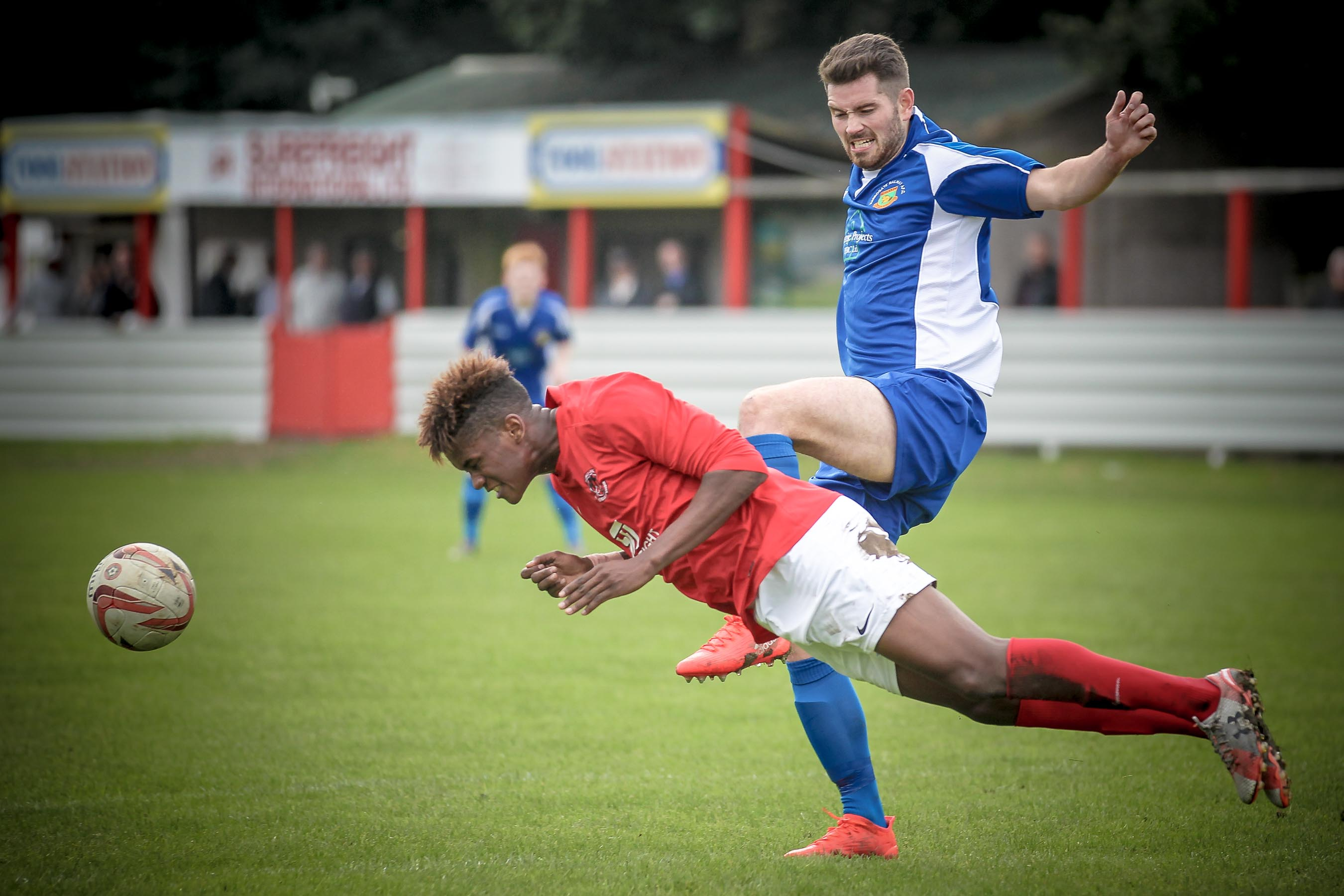 Thackley defender gets a header in as Greg Kidd pulls out from the challenge.