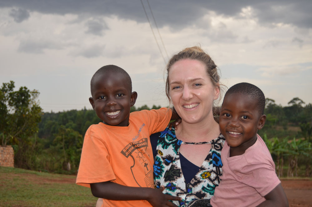 Highfield Prep School teacher, Vicki Van Zeller, with children from Bombo village school in Uganda