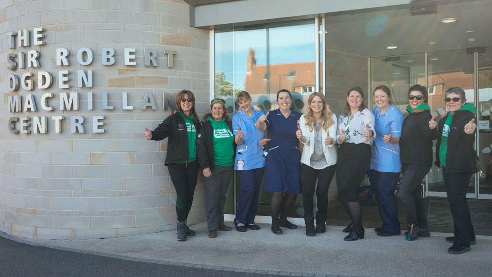 Thumbs up for a successful challenge…(L-R): Helen Stobart; Edwina Sorkin; Heather Priestley, chemotherapy nurse; Brenda McKenzie, unit manager; actress Emma Atkins; Sarah Grant, information and health and wellbeing manager; Rachel Sanderson, chemotherapy nurse; Liz Tinkler and Kate Sleath