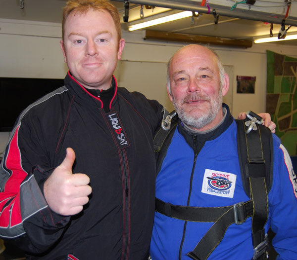 Peter Jones with his tandem skydive instructor