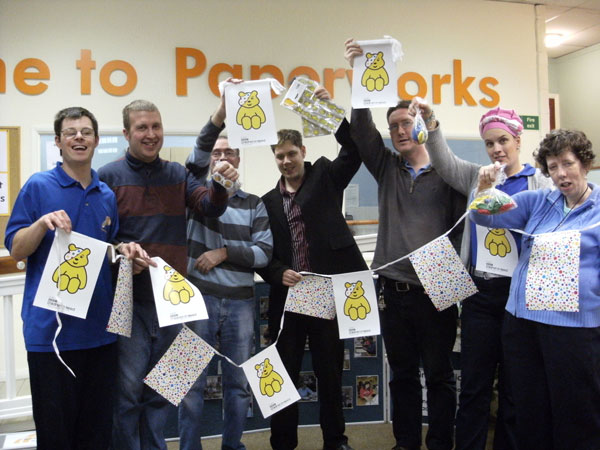 Trainees celebrate the completion of a high profile contract for BBC Children in Need last year.