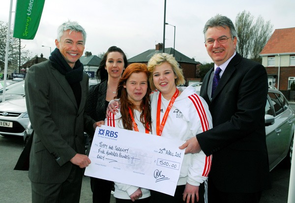 Harrogate Paralympics hopefuls twin sisters Poppy and Serenity Howell receive a sponsorship cheque from Olympic gold Medallist Jonathan Edwards on behalf of Benfield Ford, Harrogate. (Left to right) Jonathan Edwards, Melissa Leach, Teaching Assistant, Poppy and Serenity Howell and Benfield Ford, General Manager, Nigel Clayton