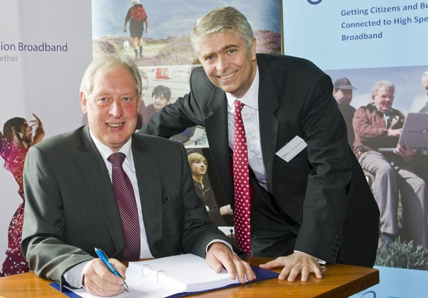 John Moore (left), Corporate Director, Finance and Central Services, North Yorkshire County Council, and Bill Murphy, Managing Director, Next Generation Access, BT, signing the Connecting North Yorkshire contract