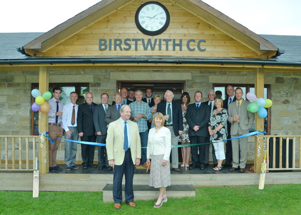 Birstwith Cricket Pavilion is officially opened by the club's landlords David and Vicky Gaunt watched by Club Members, families and friends (photo Brian Thompson)