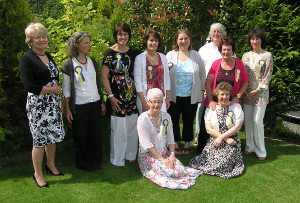 · Pictured marking the century of caring are (back row, from left) Frances Williams (14 years' service), Sue Clements (12), Stella Elson (11), Heather Smith (10), Rachel Waddington (11), Anne Smyth (20), Jill Smith (14) and Nina Derbyshire (11). Kneeling (from left) are Sheila Constable (12) and Catherine Thompson (10)
