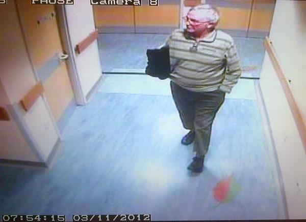 Graham Roskell leaving Harrogate Hospital on 3 November 2012