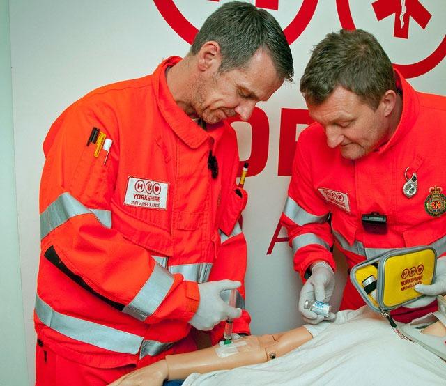 Yorkshire Air Ambulance paramedics Darrel Cullen and Lee Davison practice administering ketamine on a training mannequin