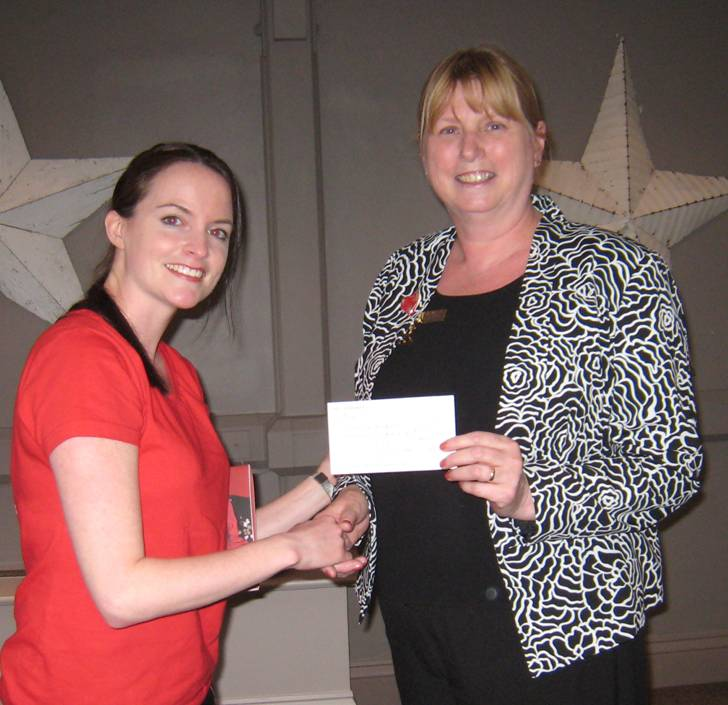 Sharon Oakley, BHF Fundraising Manager for Harrogate, receives a cheque from outgoing President Gillian Trotter