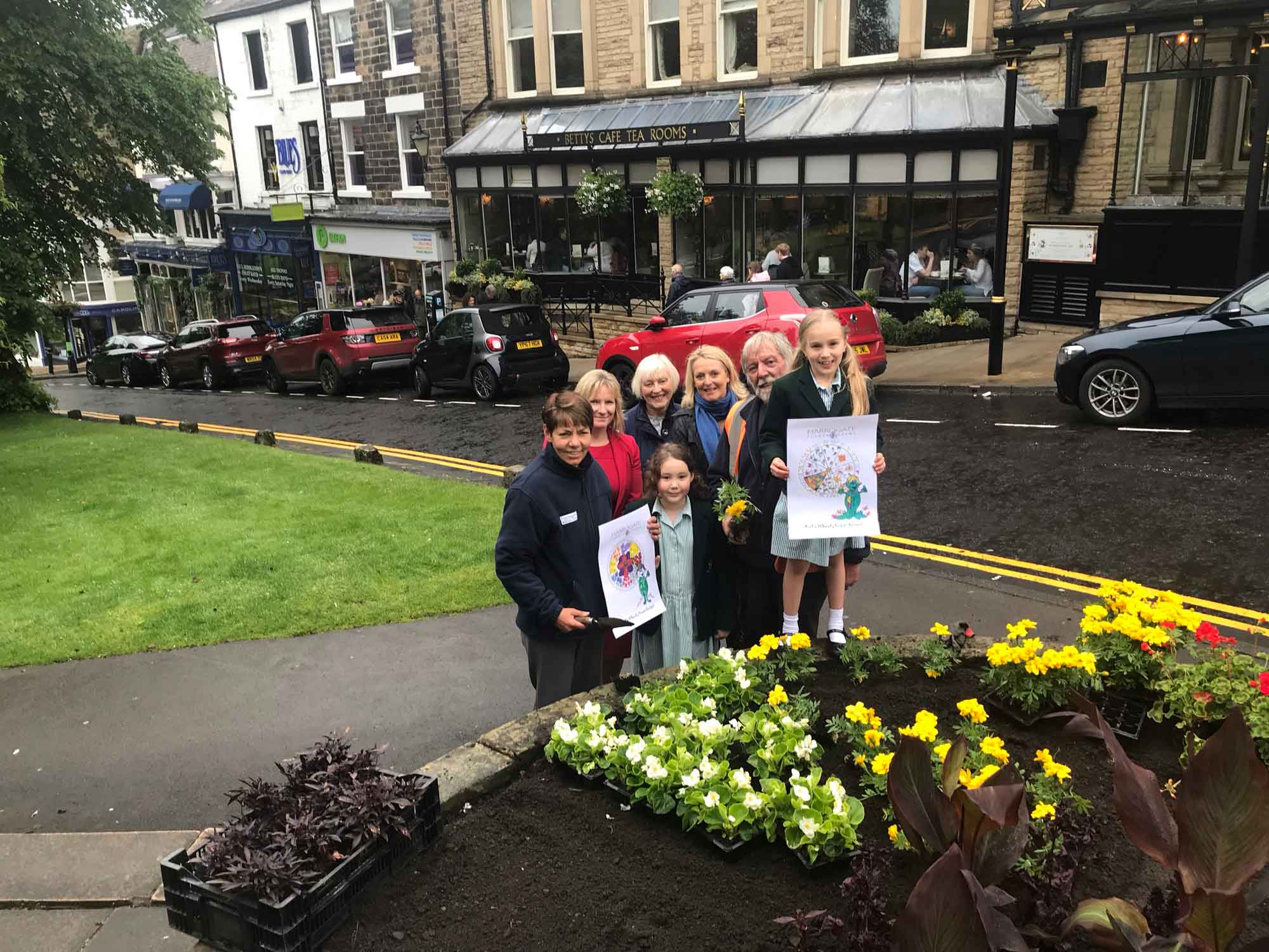 pictured is Head Teacher Nicola Matthews, Horticultural Officer Sue Wood and Gardener Richard Gilbert along with Pam Grant, President of Harrogate in Bloom and Fiona Fisk of competition sponsor Harrogate Flower Shows
