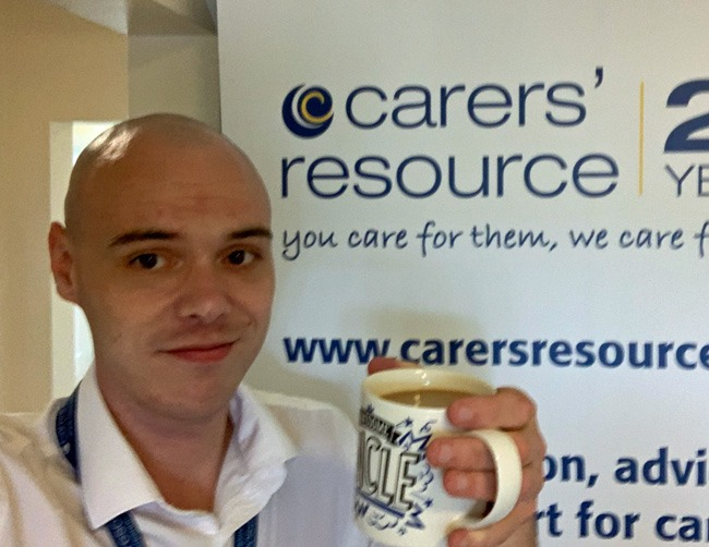 Care@ Carers' Resource registered manager in Skipton James Elwood raises a drink to carers