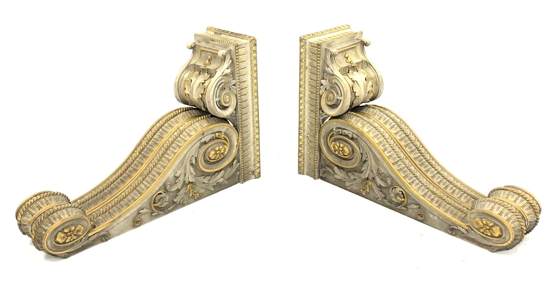 Pair of early Victorian parcel-gilt and white painted architectural brackets