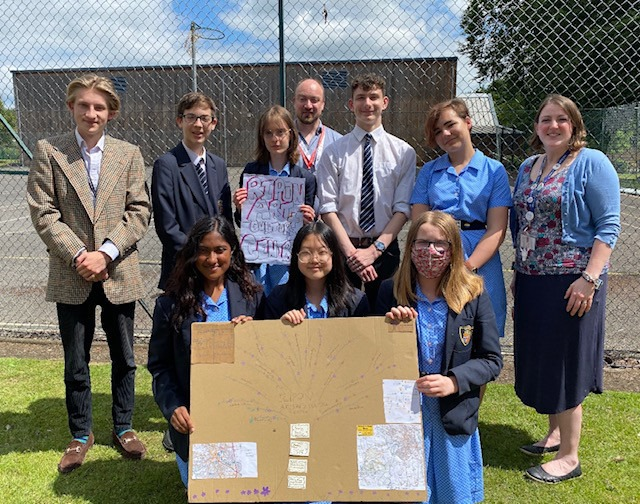 the winning team with (l-r) George Vivian, David Ault and teacher Mrs Lyons and students at work